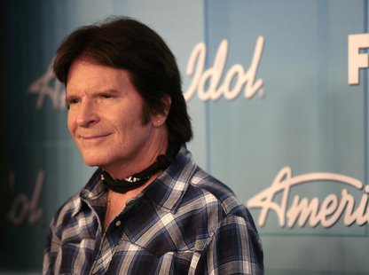 "Singer John Fogerty poses in the backroom after performing at the 11th season finale of ""American Idol"" in Los Angeles, California, May 23,"