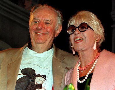 Italian playwright Dario Fo (L) and his wife Franca Rame pose prior to a news conference October 10, 1997. ITALY NOBEL