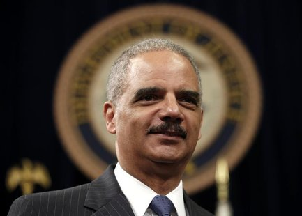 U.S. Attorney General Eric Holder looks on during a special naturalization ceremony at the Department of Justice in Washington May 28, 2013.