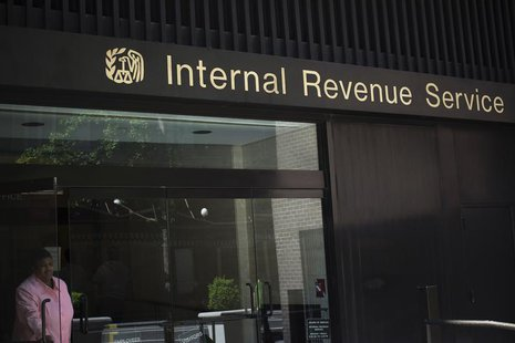 woman walks out of the Internal Revenue Service building in New York