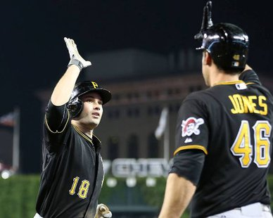 Pittsburgh's Neil Walker (L) is congratulated by fellow infielder Garrett Jones after his 11th inning homer gave the Pirates a 1-0 victory over the Detroit Tigers at Comerica Park on May 28, 2013. (photo courtesy Pittsburgh Pirates)