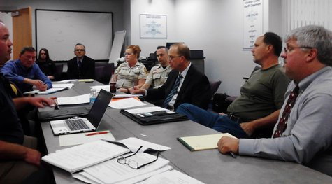 Members of the Jail Safety Panel meet with Correction officers Bill Baudry and Danielle Gray (center left) and Judge Mike Moran (far right), May 28, 2013