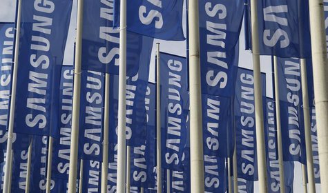 Samsung flags are set up at the main entrance to the Berlin fair ground before the IFA consumer electronics fair in Berlin, August 28, 2012.