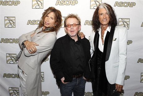 Steven Tyler (L) and Joe Perry (R) of the group Aerosmith pose with ASCAP president Paul Williams during a photo opportunity in Los Angeles