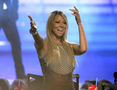 "Judge Mariah Carey waves during the Season 12 finale of ""American Idol"" in Los Angeles, Calfiornia May 16, 2013. REUTERS/Phil McCarten"