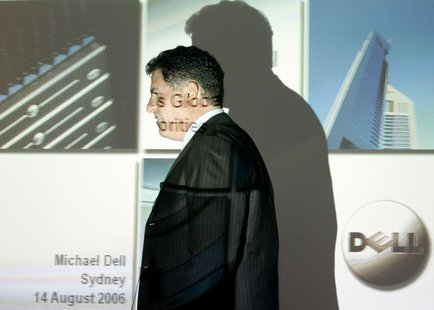 Founder and chairman of Dell computers Michael Dell passes a screen projection before speaking at a news conference in Sydney August 14, 200