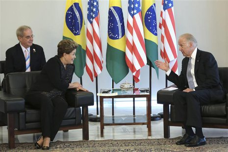 U.S. Vice President Joe Biden (R) speaks to Brazil's President Dilma Rousseff during a meeting on his visit to Brazil, at the Planalto Palac