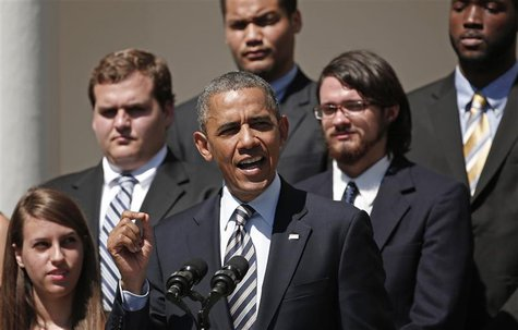 Students listen as U.S. President Barack Obama makes remarks on student loans from the White House in Washington May 31, 2013. REUTERS/Kevin