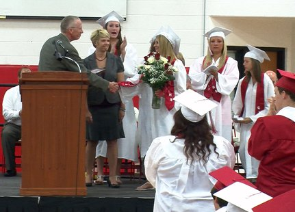 Coldwater High School senior Kylie Dudek receives a standing ovation from her classmates after a state proclamation honoring her athletic and academic achievements was read by State Senator Bruce Caswell during Senior Convocation on May 31, 2013.