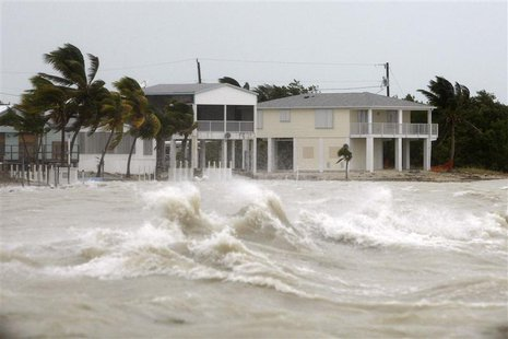 Strong waves crash around coastal houses in Key West, Florida, as Hurricane Ike passes to the south in this September 9, 2008 file photo. RE