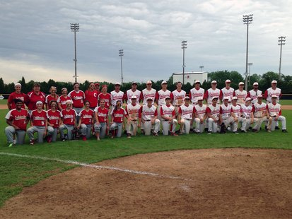 The Coldwater Cardinal softball and baseball teams pose at Pat Lowe Field with their MHSAA District Championship trophies on June 1, 2013.