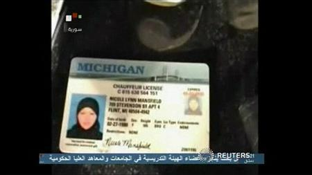 A still image taken from video broadcasted by Syrian TV on May 30, 2013, shows a Michigan driving license that Syrian TV say belongs to 33-year-old U.S. citizen Nicole Mansfield, it claims was killed in Syria while fighting with opposition forces against the government of Syrian President Bashar al-Assad in the country's civil war, her family said. REUTERS/Syrian TV via Reuters TV