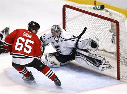 Los Angeles Kings goalie Jonathan Quick stops Chicago Blackhawks' Andrew Shaw in the second period of Game 1 of their NHL Western Conference
