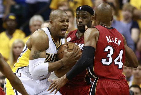Indiana Pacers' David West (L) battles to the basket against Miami Heat's LeBron James (C) and Ray Allen in Game 6 of their NBA Eastern Conf