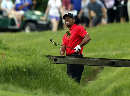 Tiger Woods of the U.S. hits his second shot from the rough on the 11th hole during the final round of the Memorial Tournament at Muirfield