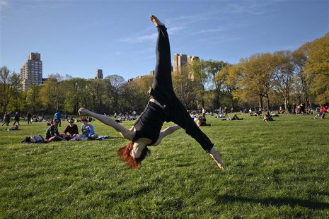 A woman practices aerobic moves in New York's Central Park on April 8, 2012. REUTERS/Eduardo Munoz