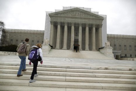 Tourists walk in front of the Supreme Court building in Washington, March 24, 2013. REUTERS/Jonathan Ernst