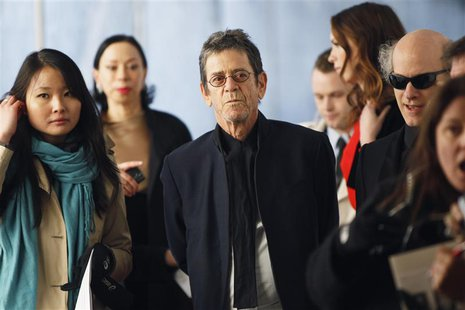 "Musician Lou Reed (C) arrives for the Metropolitan Opera's premiere of ""Le Comte Ory"" at Lincoln Center in New York March 24, 2011. REUTERS/"