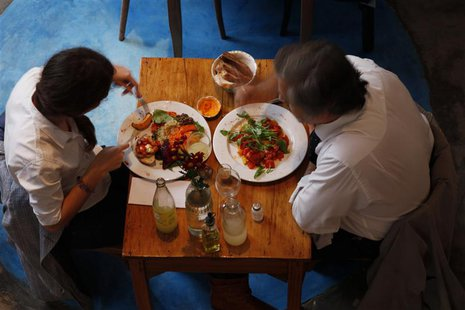 A couple lunches at vegetarian restaurant Artemisia in Buenos Aires July 7, 2010. REUTERS/Martin Acosta