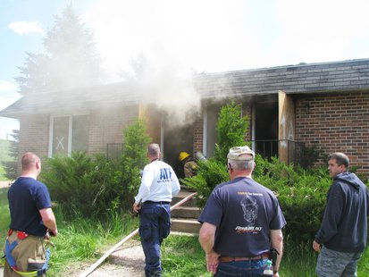 Wausau fire crews move in to extinguish a training fire in a blighted apartment building, June 3 2013