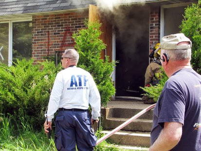 ATF officials oversee a training burn in Wausau, June 3 2013