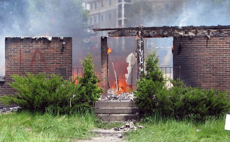 The remains of a blighted apartment building burn after Wausau and ATF fire crews complete training on the structure, June 3 2013