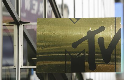 The MTV logo can be seen on a sign in front of the MTV studios in Times Square New York December 12, 2007. REUTERS/Lucas Jackson