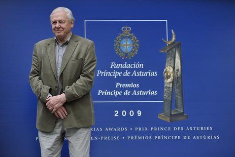 British naturalist David Attenborough poses for photographers after arriving in Oviedo, northern Spain, October 21, 2009. REUTERS/Eloy Alons