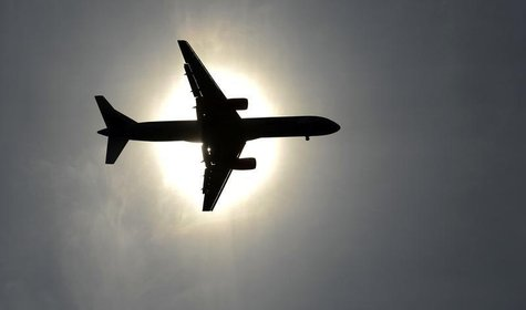 A plane approaching Leeds Bradford airport passes in front of the sun during the second test cricket match between England and New Zealand a