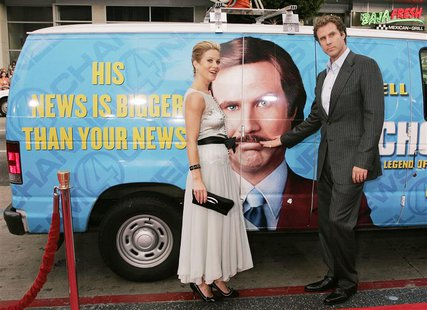 "Actor Will Ferrell and actress Christina Applegate pose next to a ""news van"" which they arrived in for the premiere of their new comedy film"