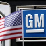 The U.S. flag flies at the Burt GM auto dealer in Denver June 1, 2009. REUTERS/Rick Wilking