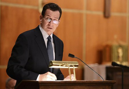 Dannel Malloy, Governor of Connecticut speaks to mourners gathererd inside the St. Rose of Lima Roman Catholic Church at a vigil service for
