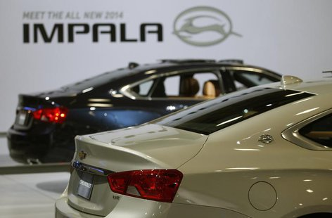 Two new 2014 Chevrolet Impala sedans are seen at the Washington Auto show February 6, 2013. REUTERS/Gary Cameron