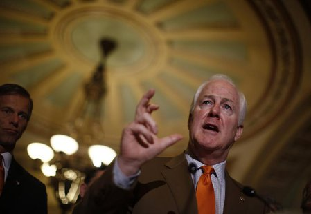 U.S. Senator John Cornyn speaks to the media following the weekly Republican Senate policy meeting on Capitol Hill in Washington, February 2