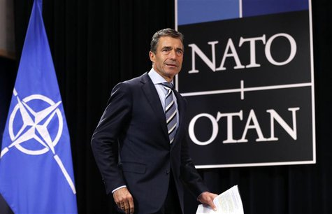 NATO Secretary General Anders Fogh Rasmussen arrives to address a news conference during a NATO defence ministers meeting at the Alliance he