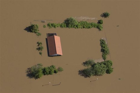 A house stands almost fully immersed in the water of the Elbe near the city of Meissen after the river broke its bank during a flood, June 5