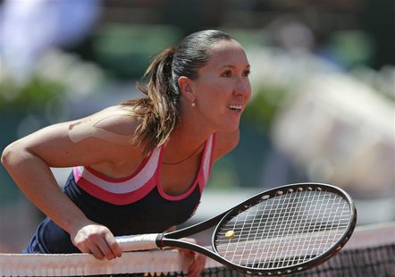Jelena Jankovic of Serbia checks a line call during her women's singles quarter-final match against Maria Sharapova of Russia at the French