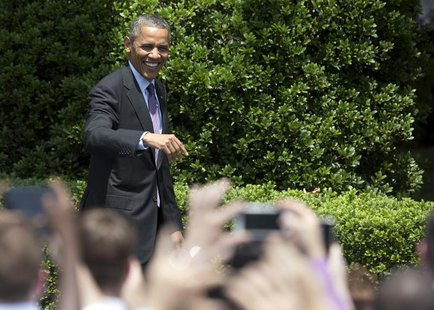 U.S. President Barack Obama waves to fans before honoring the Baltimore Ravens team and their Super Bowl XLVII victory on the South Lawn of