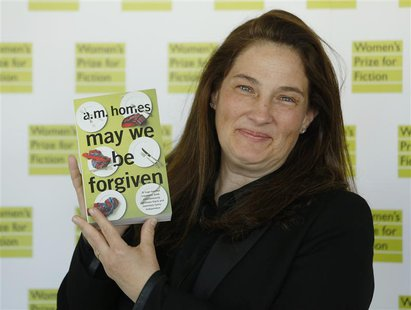 "A.M. Homes, author of ""May We Be Forgiven"", poses for photographers before the announcement of the 2013 Women's Prize for Fiction at the Roy"