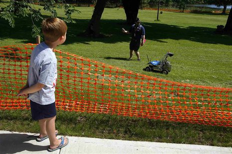Five-year-old Brady Chapman watches a robot from Kuukulgur team from Estonia compete in NASA's 2013 Sample Return Robot Challenge at the Wor