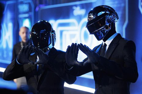 "Musicians Thomas Banglater and Guy-Manuel de Homem-Christo of Daft Punk pose at the world premiere of the film ""TRON: Legacy"" in Hollywood,"