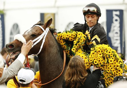 Jockey Gary Stevens aboard Oxbow celebrates winning the 138th running of the Preakness Stakes at Pimlico Race Course in Baltimore, Maryland