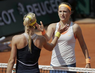 Victoria Azarenka (R) of Belarus shakes hands with Maria Kirilenko of Russia after their women's singles quarter-final match during the Fren