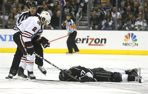 Chicago Blackhawks' Duncan Keith looks down at Los Angeles Kings' Jeff Carter after Keith hit Carter in the face with his stick in the secon
