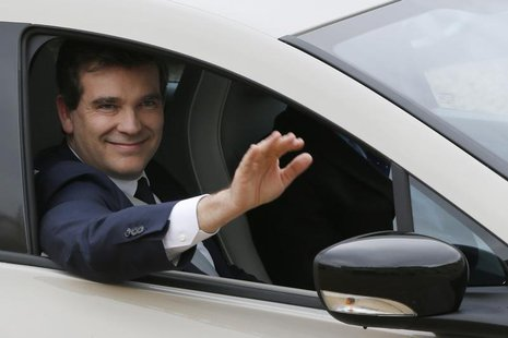 French Minister for Industrial Recovery Arnaud Montebourg waves goodbye after attending a ministers' meeting at the Elysee Palace in Paris M