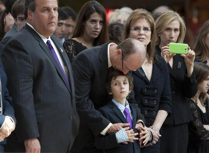 (L - R) New Jersey Governor Chris Christie, Senator Frank Lautenberg's son Josh, grandson Sam and wife Bonnie look on as Frank Lautenberg's