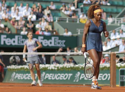 Serena Williams of the U.S. pumps her fist during her women's singles semi-final match against Sara Errani of Italy (L) at the French Open t