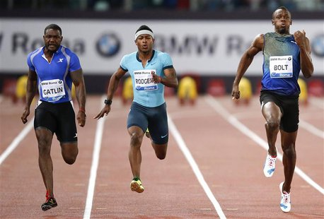 Usain Bolt of Jamaica (R) competes with Justin Gatlin of the U.S. (L) during the men's 100m event at the Golden Gala IAAF Diamond League at