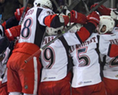Members of the Grand Rapids Griffins celebrate following their 5-4 AHL playoff victory over Oklahoma City at Van Andel Arena on June 5, 2013. (GRAND RAPIDS GRIFFINS/Mark Newman)