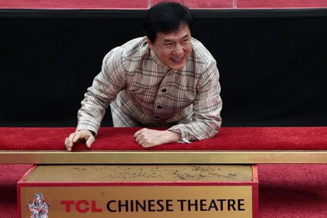 Actor Jackie Chan poses during a hand and footprint ceremony at the TCL Chinese Theatre in Hollywood, California, June 6, 2013. REUTERS/Jona